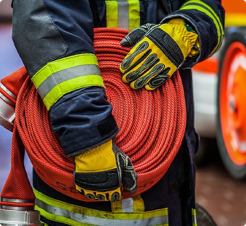 Fire Fighter Holding Hose