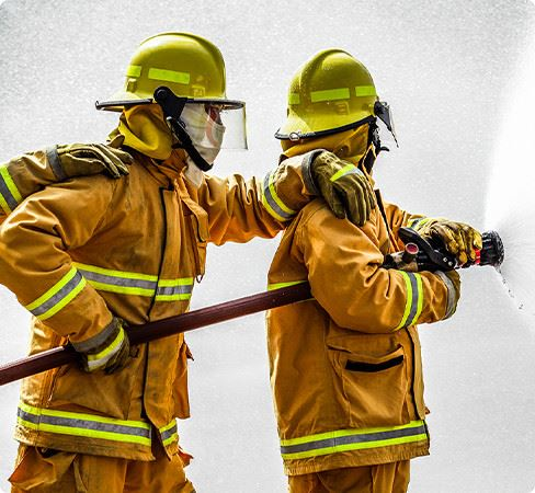 Two Fire Fighters Spraying Water