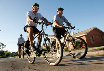 Chief Chitwood and officer patrol neighborhoods on bicycles