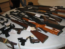 table with various guns on display